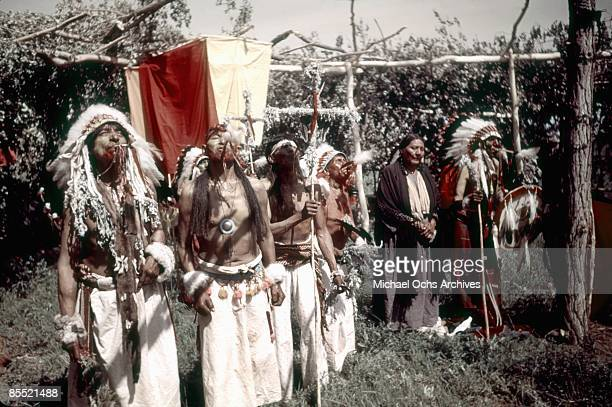 S: Native Americans blow Eagle bone Whistles while participating in the Sun Dance during the Inter-Tribal Indian Ceremonial circa late 1940's in...