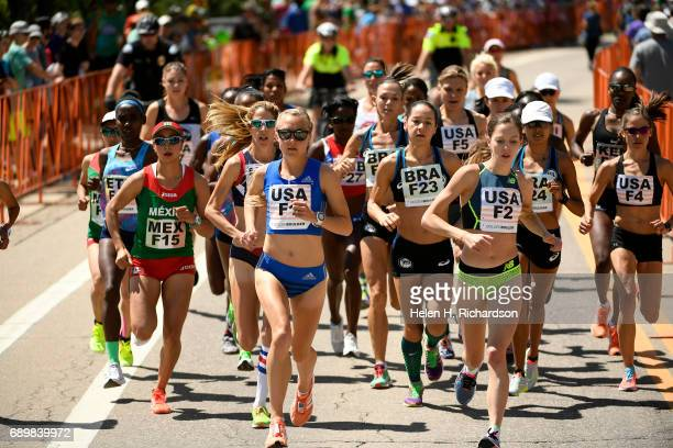 USA's Neely Gracey F1 middle and Natosha Rogers F2 establish an early lead as runners position themselves quickly in the front of the pack during the...