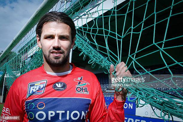 OHL's new goalkeeper Logan Bailly poses for a photograph after a press conference by Belgian first division soccer team OHLeuven on June 22 in...