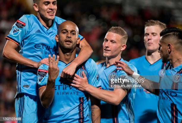S New York City FC Brazilian player Heber Araujo celebrates with teammates his goal against Costa Rica's San Carlos during their CONCACAF Champions...