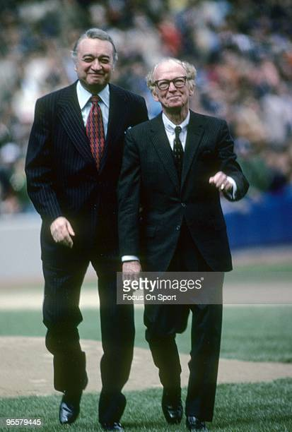 S: New York Yankees play by play announcer Mel Allen walks of the field with former Yankee radio announcer Red Barber prior to a Major League...