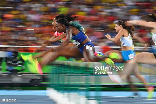 S Nia Ali competes in the Women's 100m Hurdles Semifinal during the athletics event at the Rio 2016 Olympic Games at the Olympic Stadium in Rio de...