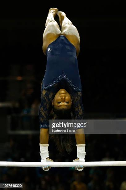 UCLA's Nia Dennis competes on uneven bars during a PAC12 meet against Arizona State at Pauley Pavilion on January 21 2019 in Los Angeles California