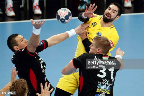PSG's Nikola Karabatic and Veszprem's Blaz Blagotinsek during the Champions League match between Veszprem and Paris Saint Germain on November 18 2017...