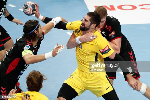 PSG's Nikola Karabatic and Veszprem's Laszlo Nagy during the Champions League match between Veszprem and Paris Saint Germain on November 18 2017 in...