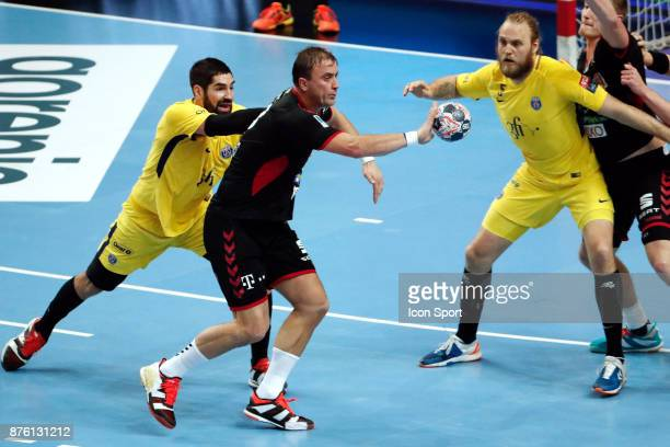 PSG's Nikola Karabatic and Veszprem's Momir Ilic during the Champions League match between Veszprem and Paris Saint Germain on November 18 2017 in...