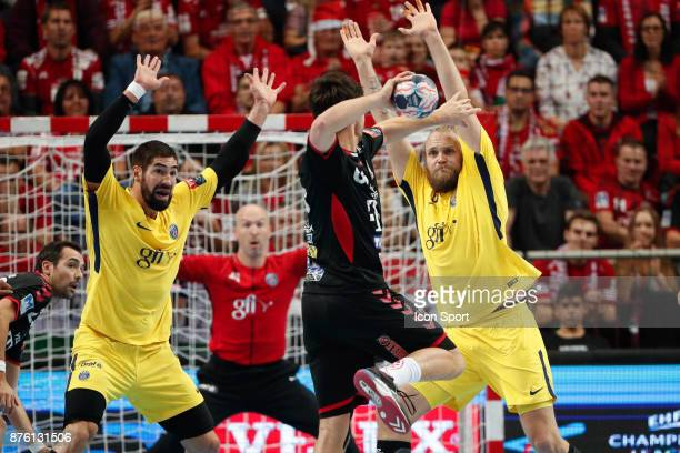 PSG's Nikola Karabatic Henrik Mollgaard and Veszprem's Momir Ilic during the Champions League match between Veszprem and Paris Saint Germain on...