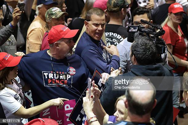 CNN's Noah Gray is shoved and shouted at by supporters of Republican presidential nominee Donald Trump as he trys to cover breaking news during a...