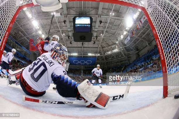 USA's Noah Welch checks Russia's Nikolai Prokhorkin after he scored past USA's Ryan Zapolski in the men's preliminary round ice hockey match between...