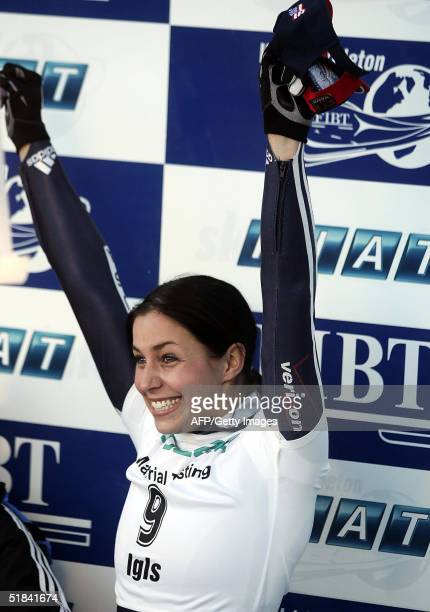 US's Noelle PikusPace celebrates on the podium after winning the Women's Skeleton World Cup competition in Innsbruck 09 December 2004 AFP PHOTO/...