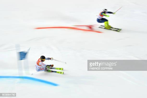 TOPSHOT USA's Nolan Kasper and Britain's Dave Ryding compete in the Alpine Skiing Team Event 1/8 finals at the Jeongseon Alpine Center during the...
