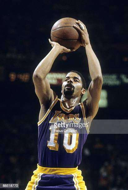 BALTIMORE MD CIRCA 1980's Norm Nixon of the Los Angeles Lakers in action shooting a free throw against the Washington Bullets during an early circa...
