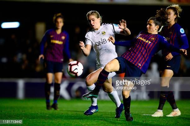LSK's Norwegian forward Elise Thorsnes challenges Barcelona's Spanish defender Andrea Pereira during the UEFA Women's Champions League quarterfinal...
