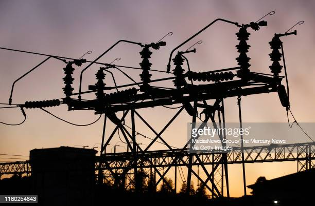 S Oakland K substation is silhouetted at sunset in the hills of Oakland, Calif., on Wednesday, Oct. 9, 2019. Power was supposed to go out at noon in...