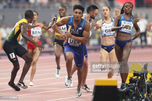 USA's Obi Ibgokwe competes in the Mixed 4 x 400m Relay heats at the 2019 IAAF World Athletics Championships at the Khalifa International stadium in...