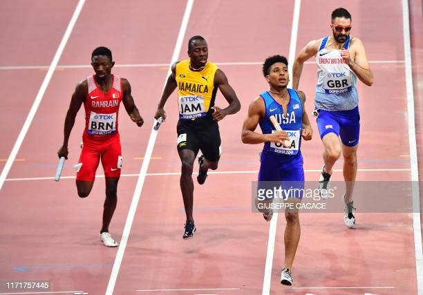 USA's Obi Ibgokwe crosses the finish line to win the Mixed 4 x 400m Relay heats at the 2019 IAAF World Athletics Championships at the Khalifa...