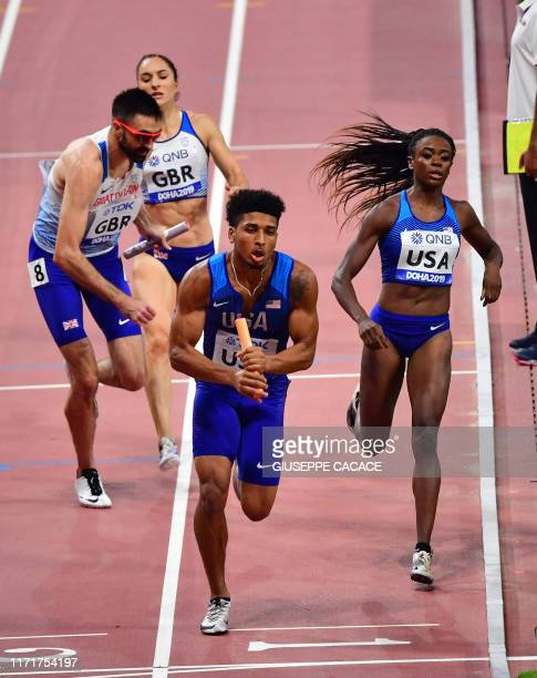 USA's Obi Ibgokwe receives the baton from USA's Jasmine Blocker in the Mixed 4 x 400m Relay heats at the 2019 IAAF World Athletics Championships at...