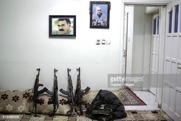 AK47's of armed group Patriotic Revolutionary Youth Movement a youth division of the Kurdistan Workers' Party PKK stand under jailed Kurdish rebel...