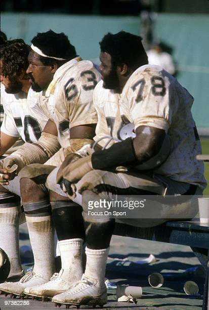 CIRCA 1970's Offensive tackle Art Shell guard Gene Upshaw of the Oakland Raiders watches the action from the bench circa 1970's during an NFL...