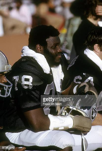 OAKLAND CA CIRCA 1970's Offensive tackle Art Shell of the Oakland Raiders watches the action from the bench circa 1970's during an NFL football game...