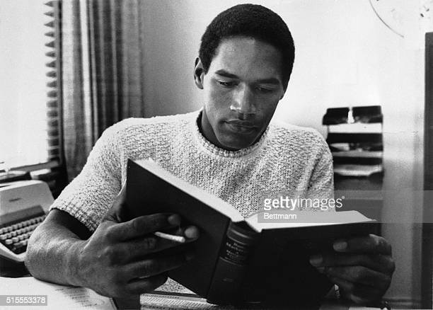 USC's OJ Simpson does spend time on his books but for all most sports fans know he does nothing but play football OJ is USC's AllAmerican halfback...