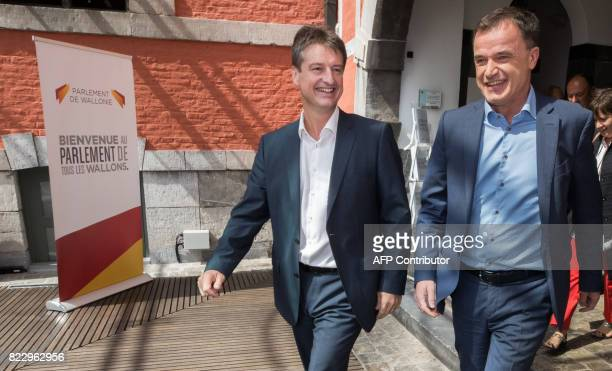 MR's Olivier Chastel and cdH's Benoit Lutgen arrive for a press conference to present the members of the new Walloon government at the Walloon...