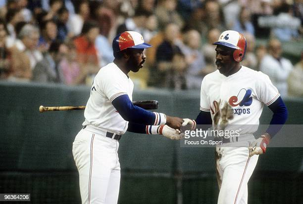 MONTREAL QC CIRCA 1980's Outfielder Andre Dawson of the Montreal Expos after hitting a homerun shakes hands with teammate Al Oliver during a mid...