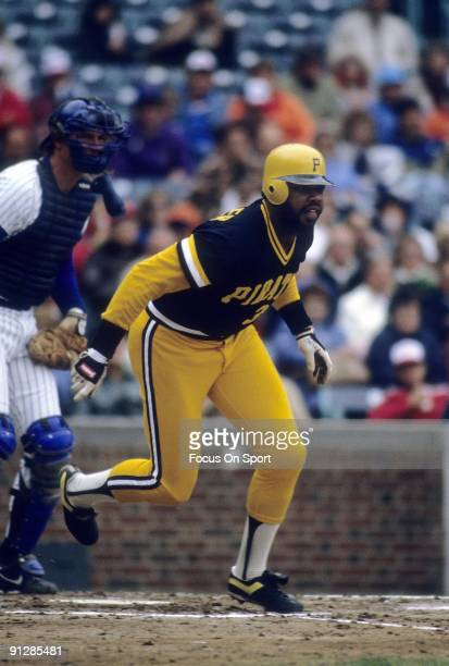 CHICAGO IL CIRCA 1970's Outfielder Dave Parker of the Pittsburgh Pirates swings and watches the flight of his ball against the Chicago Cubs during a...