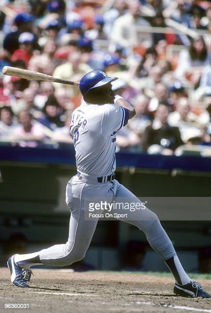 S: Outfielder Dusty Baker of the Los Angeles Dodgers swings and watches the flight of his ball against the New York Mets during a late circa 1970's...