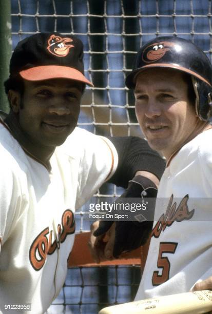 BALTIMORE MD CIRCA 1960's Outfielder Frank Robinson infielder Brooks Robinson poses for this photo during batting practice before a circa late 1960's...