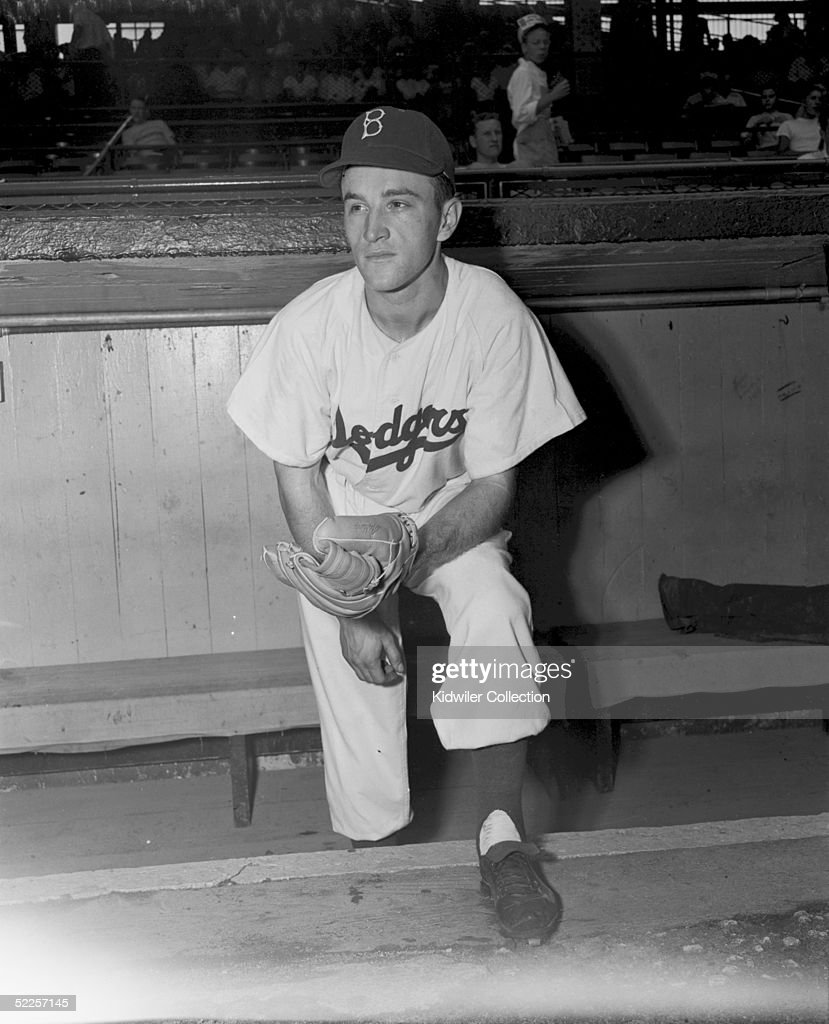 BROOKLYN, NY - 1950's: Outfielder George 'Shotgun' Shuba of the Brooklyn Dodgers poses for a circa 1950's portrait in the dugout at Ebbets Field in Brooklyn, New York.