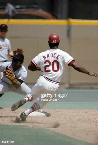 ST LOUIS MO CIRCA 1970's Outfielder Lou Brock of the St Louis Cardinals steals second base against the San Francisco Giants during a MLB baseball...