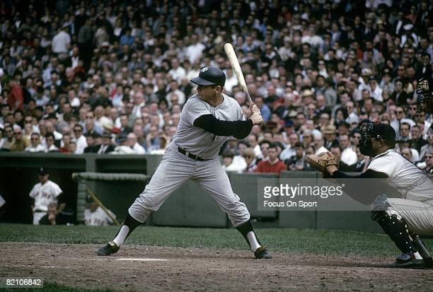 BOSTON MA CIRCA 1960's Outfielder Mickey Mantle of the New York Yankees stands at the plate ready to hit against the Boston Red Sox during a circa...