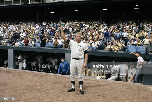 BRONX NY CIRCA 1960's Outfielder Mickey Mantle of the New York Yankees tips his cap to the fans during a circa 1960's Major League Baseball game at...