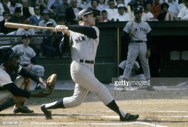CIRCA 1960's Outfielder Mickey Mantle of the New York Yankees watches the flight of his ball as he follows through on a swing during a circa 1960's...
