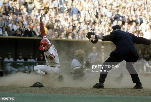 CINCINNATI OH CIRCA 1970's Outfielder Pete Rose of the Cincinnati Reds slides in safe at homeplate against the Pittsburgh Pirtates during a MLB...