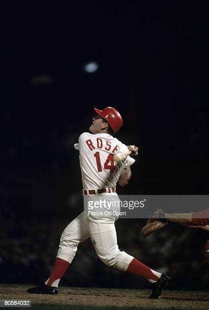 S: Outfielder Pete Rose of the Cincinnati Reds swings and watches the flight of his ball during a MLB baseball game circa late 1960's at Cosley Field...