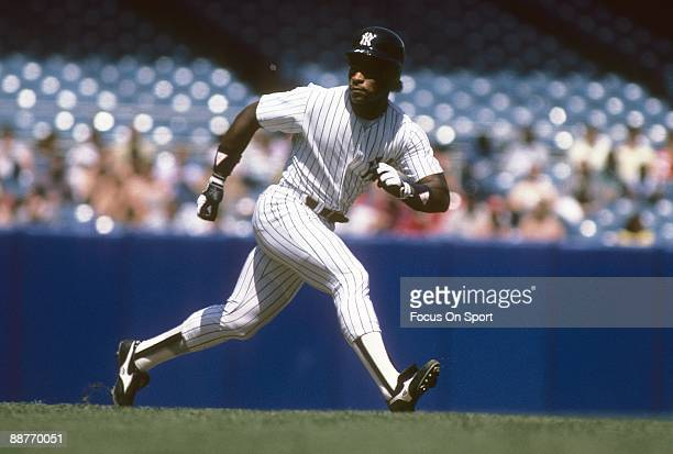 BRONX NY CIRCA 1980's Outfielder Rickey Henderson of the New York Yankees running the bases during a mid circa 1980's Major League baseball game at...