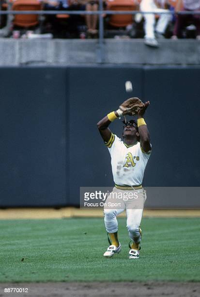 OAKLAND CA CIRCA 1980's Outfielder Rickey Henderson of the Oakland Athletics catches a fly ball in left field during an early circa 1980's Major...