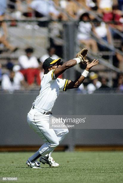 OAKLAND CA CIRCA 1980's Outfielder Rickey Henderson of the Oakland Athletics tracks a fly ball in left field during an early circa 1980's Major...