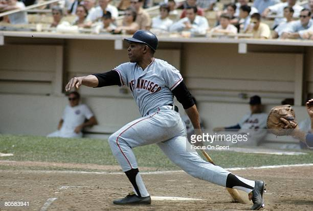 FLUSHING NY CIRCA 1970's Outfielder Willie Mays of the San Francisco Giants swings and watches the flight of his ball against the New York Mets...