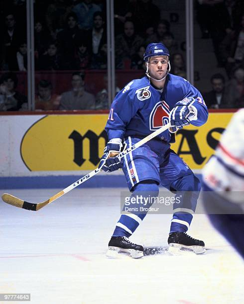 MONTREAL 1990's Owen Nolan of the Quebec Nordiques skates against the Montreal Canadiens in the early 1990's at the Montreal Forum in Montreal Quebec...