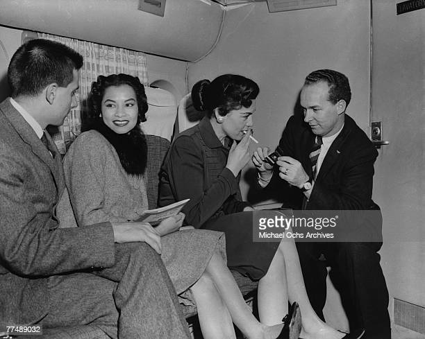 NEW YORK MID 1950's Passengers enjoy a relaxing smoke on a Transocean Air lines Boeing 377 Stratocruiser in the mid 1950's Transocean Air lines flew...