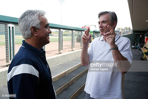 ESPN's Pedro Gomez talks with Executive Vice President of Baseball Operations Billy Beane of the Oakland Athletics in the dugout prior to a spring...