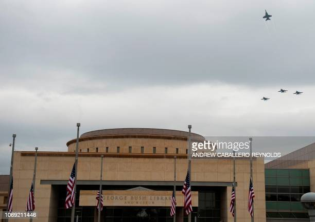 F/A18's perform a missing man formation as they fly overhead before the interment ceremony of former US President George HW Bush at the George HW...