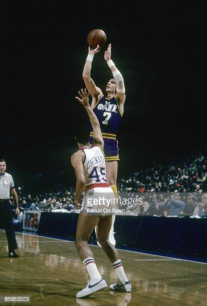 BALTIMORE MD CIRCA 1970's Pete Maravich of the New Orleans Jazz shoots over Phil Chenier of the Washington Bullets during a late circa 1970's NBA...