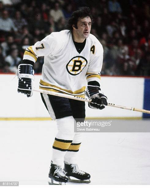 Phil Esposito of the Boston Bruins skates in game at the Boston Garden .