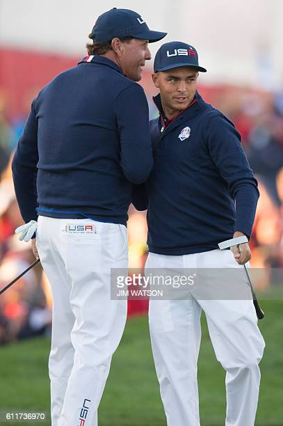 USA's Phil Mickelson and Rickie Fowler celebrate making a putt while playing the Saturday morning foursomes matches during the 41st Ryder Cup at...