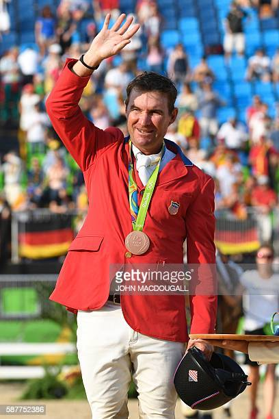 S Phillip Dutton waves from the podium after the Eventing's Jumping of the Equestrian during the 2016 Rio Olympic Games at the Olympic Equestrian...