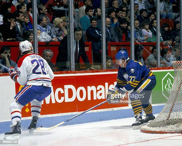 MONTREAL 1980's Pierre Turgeon of the Buffalo Sabres skates against Larry Trader of the Montreal Canadiens in the late 1980's at the Montreal Forum...